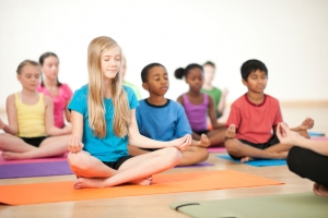 Kids doing yoga and meditating